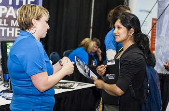 A female student talking with a female recruiter while at a career fair